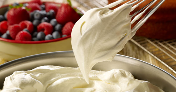 Flavor cue image of Heavy Whipping Cream in bowl with background berries by Promised Land Dairy